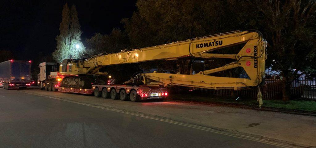 Low Loader ready to transport Komatsu large crane night time