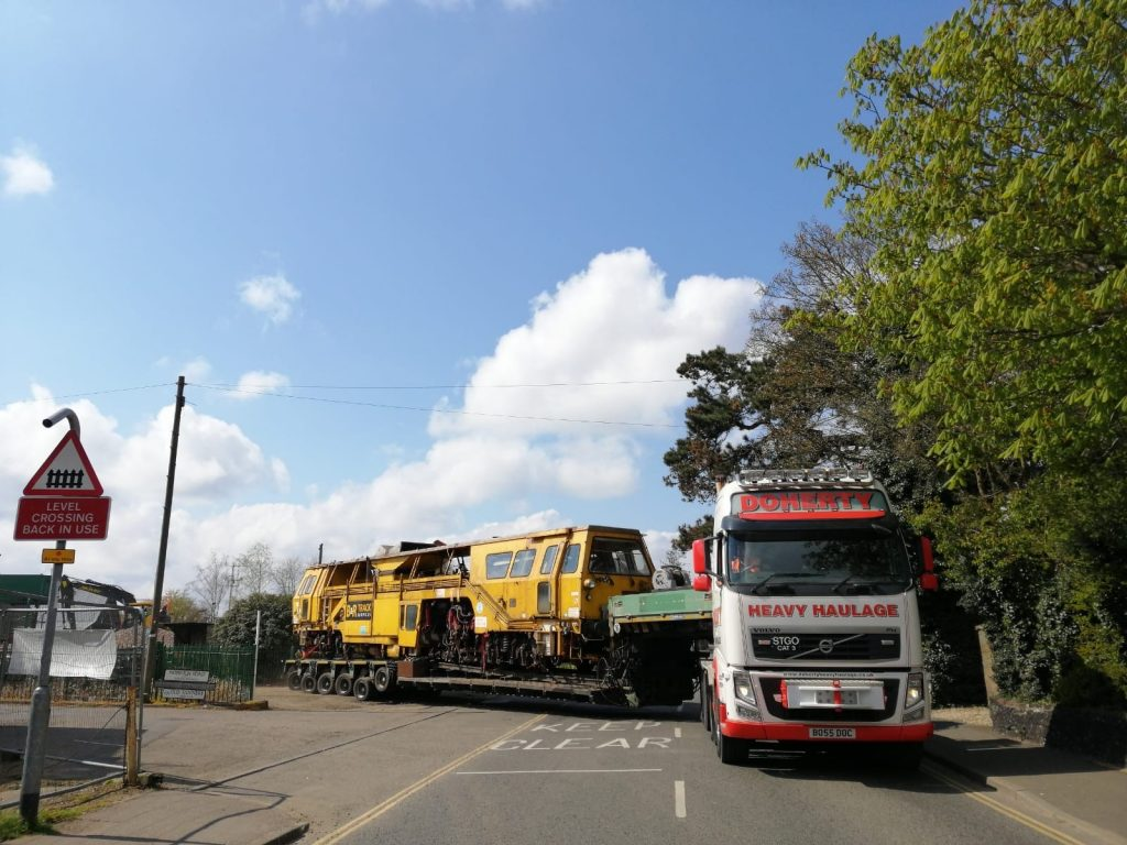 Yellow Rail Train Carriage On Its Way To A UK Destination
